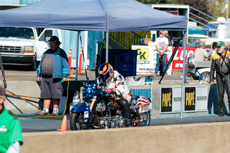 dragster: WOODBURN, OR - SEPTEMBER 27, 2015: Motorcycle dragster getting ready to race at the NHRA 30th Annual Fall Classic at the Woodburn Dragstrip.