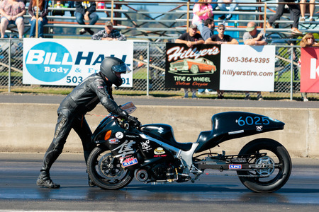 dragstrip: WOODBURN, OR - SEPTEMBER 27, 2015: Mechanical failures keep this motorcycle from starting a race at the NHRA 30th Annual Fall Classic at the Woodburn Dragstrip.