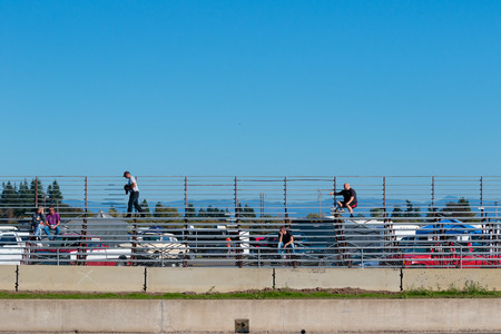 dragstrip: WOODBURN, OR - SEPTEMBER 27, 2015: Bleachers are nearly empty at the NHRA 30th Annual Fall Classic at the Woodburn Dragstrip. Editorial