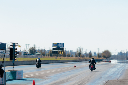 dragstrip: WOODBURN, OR - SEPTEMBER 27, 2015: Two motorcycles racing down the track at the NHRA 30th Annual Fall Classic at the Woodburn Dragstrip. Editorial