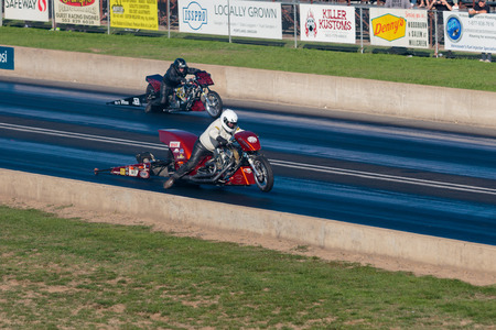 WOODBURN, OR - SEPTEMBER 27, 2015: Motorcycle dragster with the front wheel off the track during a race at the NHRA 30th Annual Fall Classic at the Woodburn Dragstrip. Editorial