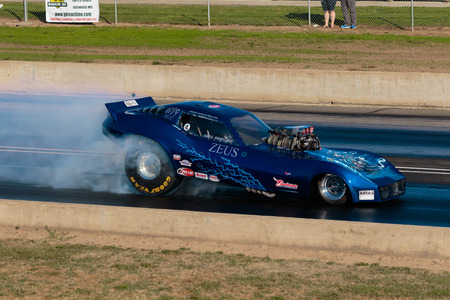dragstrip: WOODBURN, OR - SEPTEMBER 27, 2015: Funny car Zeuss performing a burnout at the NHRA 30th Annual Fall Classic at the Woodburn Dragstrip.
