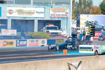 dragster: WOODBURN, OR - SEPTEMBER 27, 2015: Open top dragster at the starting line for the NHRA 30th Annual Fall Classic at the Woodburn Dragstrip.