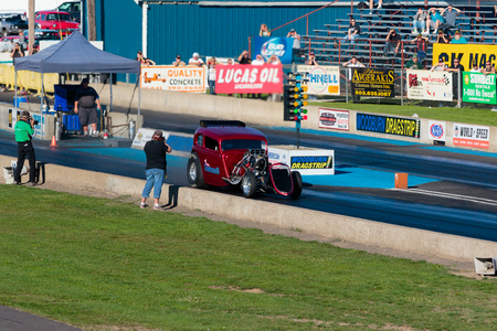 dragster: WOODBURN, OR - SEPTEMBER 27, 2015: Legends AA fuel injected dragster during a solo run at the NHRA 30th Annual Fall Classic at the Woodburn Dragstrip. Editorial