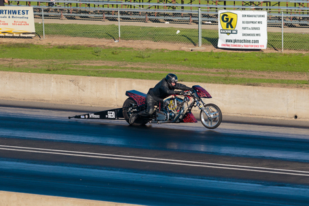 off track: WOODBURN, OR - SEPTEMBER 27, 2015: Motorcycle dragster with the front wheel off the track during a race at the NHRA 30th Annual Fall Classic at the Woodburn Dragstrip. Editorial