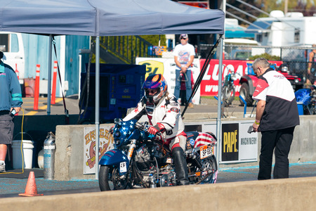 WOODBURN, OR - SEPTEMBER 27, 2015: Motorcycle dragster getting ready to race at the NHRA 30th Annual Fall Classic at the Woodburn Dragstrip.