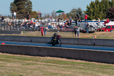 dragster: WOODBURN, OR - SEPTEMBER 27, 2015: Motorcycle dragster racing at the NHRA 30th Annual Fall Classic at the Woodburn Dragstrip.