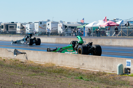 dragstrip: WOODBURN, OR - SEPTEMBER 27, 2015: Open top dragsters race each other down the track at the NHRA 30th Annual Fall Classic at the Woodburn Dragstrip.