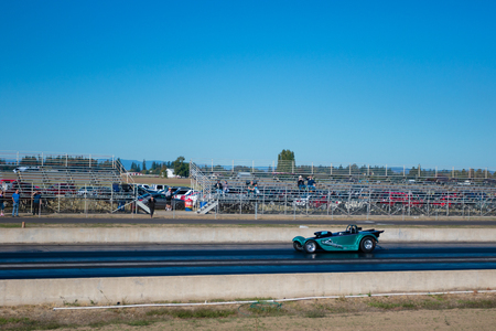 drag race: WOODBURN, OR - SEPTEMBER 27, 2015: Open shifter classification vehicle competing at the NHRA 30th Annual Fall Classic at the Woodburn Dragstrip.