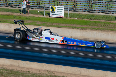 dragster: WOODBURN, OR - SEPTEMBER 27, 2015: Capitol Auto Group dragster racing at the NHRA 30th Annual Fall Classic at the Woodburn Dragstrip. Editorial