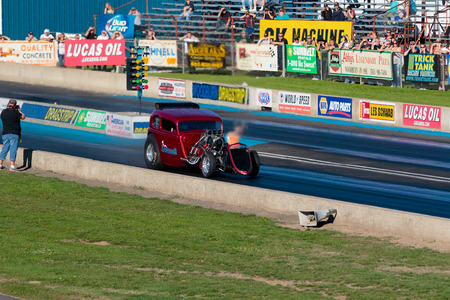 dragstrip: WOODBURN, OR - SEPTEMBER 27, 2015: Legends AA fuel injected dragster during a solo run at the NHRA 30th Annual Fall Classic at the Woodburn Dragstrip. Editorial