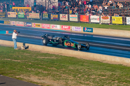dragster: WOODBURN, OR - SEPTEMBER 27, 2015: Darin Bays Warped Speed Black Rat jet dragster eclipses 250mph during the NHRA 30th Annual Fall Classic at the Woodburn Dragstrip.