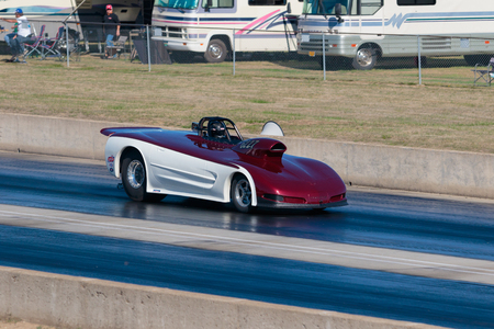 dragster: WOODBURN, OR - SEPTEMBER 27, 2015: Dragster racing down the track in the open division at the NHRA 30th Annual Fall Classic at the Woodburn Dragstrip. Editorial