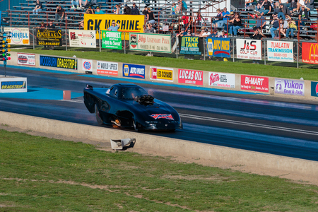 drag race: WOODBURN, OR - SEPTEMBER 27, 2015: Funny car catches fire after an engine explosion while racing down the track at the NHRA 30th Annual Fall Classic at the Woodburn Dragstrip. Editorial