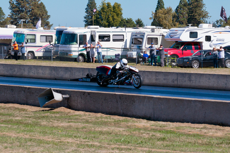 dragstrip: WOODBURN, OR - SEPTEMBER 27, 2015: Motorcycle dragster racing at the NHRA 30th Annual Fall Classic at the Woodburn Dragstrip.