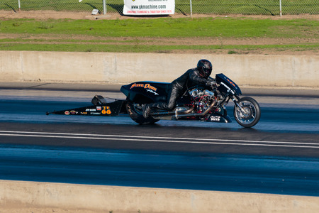 dragster: WOODBURN, OR - SEPTEMBER 27, 2015: Steve Dorn Racing motorcycle dragster at the NHRA 30th Annual Fall Classic at the Woodburn Dragstrip.