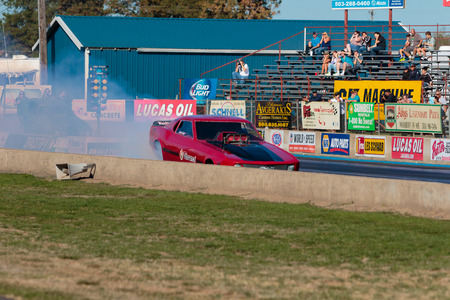 drag race: WOODBURN, OR - SEPTEMBER 27, 2015: Funny car performing a burnout at the NHRA 30th Annual Fall Classic at the Woodburn Dragstrip. Editorial
