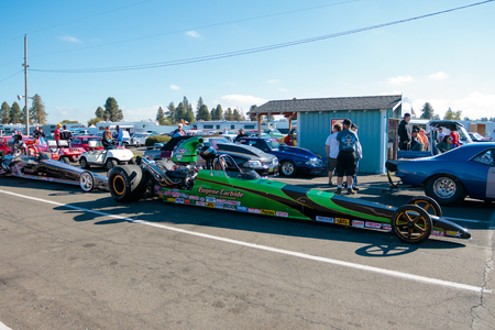 dragstrip: WOODBURN, OR - SEPTEMBER 27, 2015: Eugene Carbide dragster waiting at the starting gates for the NHRA 30th Annual Fall Classic at the Woodburn Dragstrip.