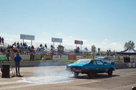 dragster: WOODBURN, OR - SEPTEMBER 27, 2015: Classic car competing in the open shifter classification at the NHRA 30th Annual Fall Classic at the Woodburn Dragstrip.