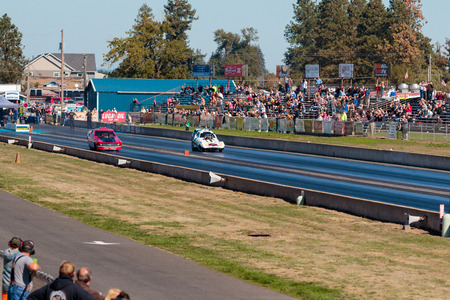 dragstrip: WOODBURN, OR - SEPTEMBER 27, 2015: Hart Braker funny car comes across the middle line during a semi-final race at the NHRA 30th Annual Fall Classic at the Woodburn Dragstrip.