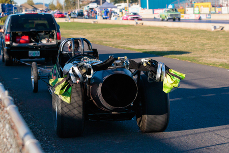 dragster: WOODBURN, OR - SEPTEMBER 27, 2015: Jet detail from the rear of Darin Bays Warped Speed Black Rat jet dragster car as it is pulled back to the starting line at the NHRA 30th Annual Fall Classic at the Woodburn Dragstrip.