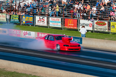 dragster: WOODBURN, OR - SEPTEMBER 27, 2015: Big block dragster racing at the NHRA 30th Annual Fall Classic at the Woodburn Dragstrip.