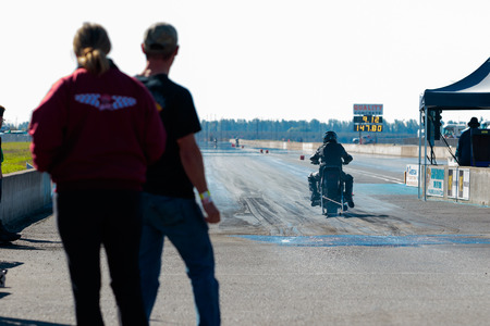 dragstrip: WOODBURN, OR - SEPTEMBER 27, 2015: Motorcycle at the starting line getting ready to compete at the NHRA 30th Annual Fall Classic at the Woodburn Dragstrip. Editorial