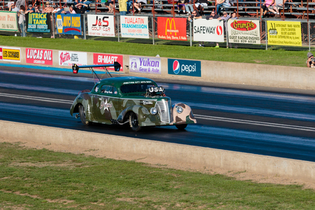 dragstrip: WOODBURN, OR - SEPTEMBER 27, 2015: The Patriot races down the track at over 200mph at the NHRA 30th Annual Fall Classic at the Woodburn Dragstrip. Editorial