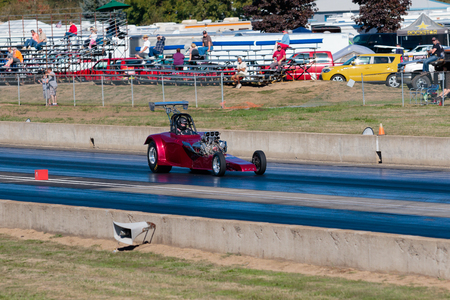 dragstrip: WOODBURN, OR - SEPTEMBER 27, 2015: Dragster racing down the track in the open division at the NHRA 30th Annual Fall Classic at the Woodburn Dragstrip. Editorial