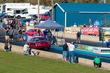 drag race: WOODBURN, OR - SEPTEMBER 27, 2015: Turbo boosted Ford Mustang with front wheels off the track at the NHRA 30th Annual Fall Classic at the Woodburn Dragstrip. Editorial
