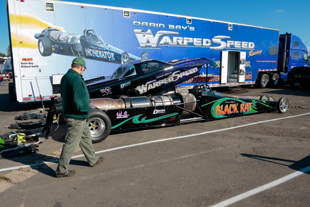 drag race: WOODBURN, OR - SEPTEMBER 27, 2015: Darin Bays Warped Speed jet dragsters prepping for a race at the NHRA 30th Annual Fall Classic at the Woodburn Dragstrip.