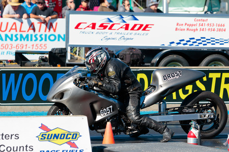 WOODBURN, OR - SEPTEMBER 27, 2015: Motorcycle at the starting line getting ready to compete at the NHRA 30th Annual Fall Classic at the Woodburn Dragstrip. Editorial