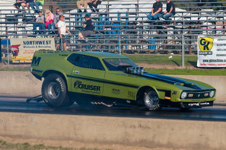 dragstrip: WOODBURN, OR - SEPTEMBER 27, 2015: Funny car performing a burnout at the NHRA 30th Annual Fall Classic at the Woodburn Dragstrip. Editorial
