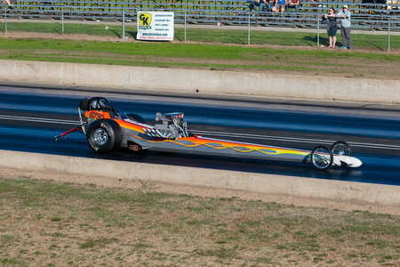 dragstrip: WOODBURN, OR - SEPTEMBER 27, 2015: Open top dragster racing down the track at the NHRA 30th Annual Fall Classic at the Woodburn Dragstrip. Editorial