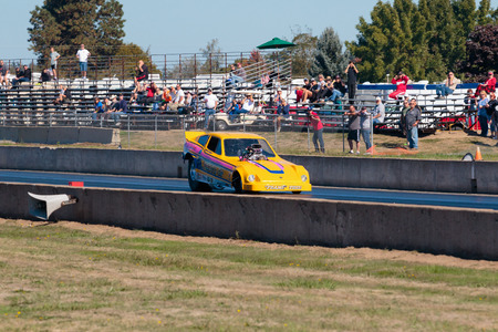 dragstrip: WOODBURN, OR - SEPTEMBER 27, 2015: Photo Op drives a solo run in the funny car division at the NHRA 30th Annual Fall Classic at the Woodburn Dragstrip.