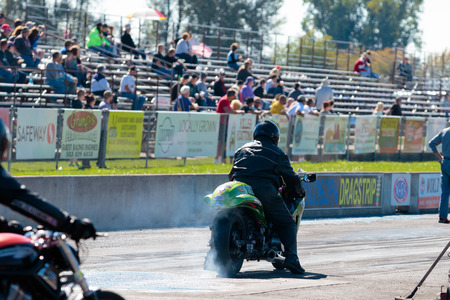 WOODBURN, OR - SEPTEMBER 27, 2015: Burnout performed before a race by a dragster motorcycle at the NHRA 30th Annual Fall Classic at the Woodburn Dragstrip.