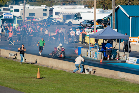dragstrip: WOODBURN, OR - SEPTEMBER 27, 2015: Motorcycle dragster performing a burnout at the NHRA 30th Annual Fall Classic at the Woodburn Dragstrip.