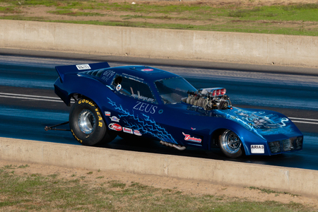 dragster: WOODBURN, OR - SEPTEMBER 27, 2015: Funny car Zeuss racing at the NHRA 30th Annual Fall Classic at the Woodburn Dragstrip.