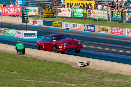 dragster: WOODBURN, OR - SEPTEMBER 27, 2015: Turbo boosted Ford Mustang with front wheels off the track at the NHRA 30th Annual Fall Classic at the Woodburn Dragstrip. Editorial
