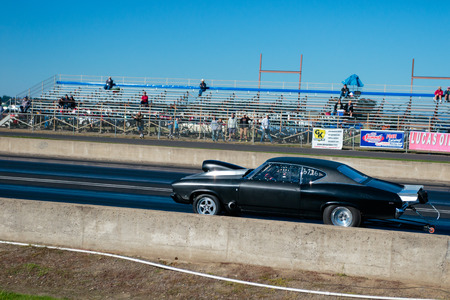 dragstrip: WOODBURN, OR - SEPTEMBER 27, 2015: Classic car dragster competing in the shifter category at the NHRA 30th Annual Fall Classic at the Woodburn Dragstrip.