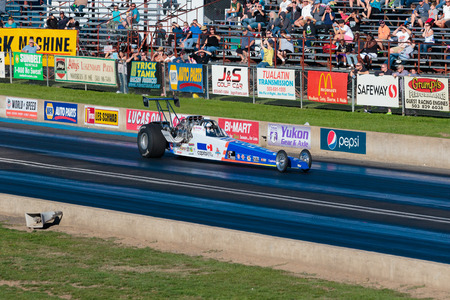 dragstrip: WOODBURN, OR - SEPTEMBER 27, 2015: Capitol Auto Group dragster racing at the NHRA 30th Annual Fall Classic at the Woodburn Dragstrip. Editorial