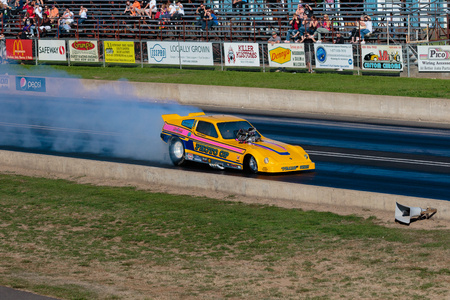 dragster: WOODBURN, OR - SEPTEMBER 27, 2015: Photo Op funny car performing a burnout at the NHRA 30th Annual Fall Classic at the Woodburn Dragstrip.