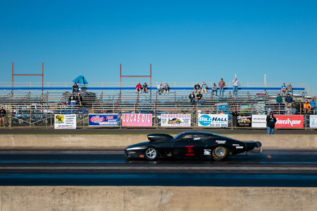 dragster: WOODBURN, OR - SEPTEMBER 27, 2015: Classic car dragster competing in the shifter category at the NHRA 30th Annual Fall Classic at the Woodburn Dragstrip.