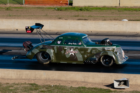 drag race: WOODBURN, OR - SEPTEMBER 27, 2015: The Patriot races down the track at over 200mph at the NHRA 30th Annual Fall Classic at the Woodburn Dragstrip. Editorial