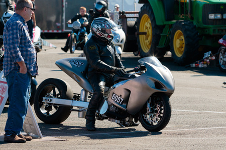 dragster: WOODBURN, OR - SEPTEMBER 27, 2015: Motorcycle dragster getting ready to start a race at the NHRA 30th Annual Fall Classic at the Woodburn Dragstrip.