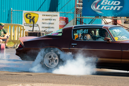 dragster: WOODBURN, OR - SEPTEMBER 27, 2015: Classic car in the nostalgia division performing a burnout at the NHRA 30th Annual Fall Classic at the Woodburn Dragstrip.
