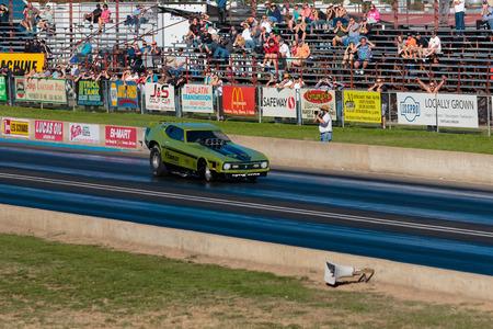 dragstrip: WOODBURN, OR - SEPTEMBER 27, 2015: Funny car racing at the NHRA 30th Annual Fall Classic at the Woodburn Dragstrip.