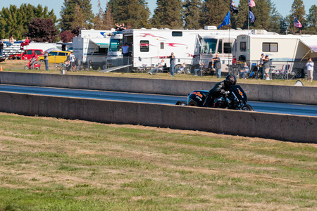 dragstrip: WOODBURN, OR - SEPTEMBER 27, 2015: Steve Dorn cruising down the race track at the NHRA 30th Annual Fall Classic at the Woodburn Dragstrip.