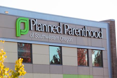 planned: EUGENE, OR - OCTOBER 4, 2015: Logo closeup of Planned Parenthood of Southwestern Oregon located in Eugene.