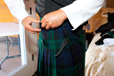 kilt: Traditional Scottish wedding day attire of a kilt worn by the groom.